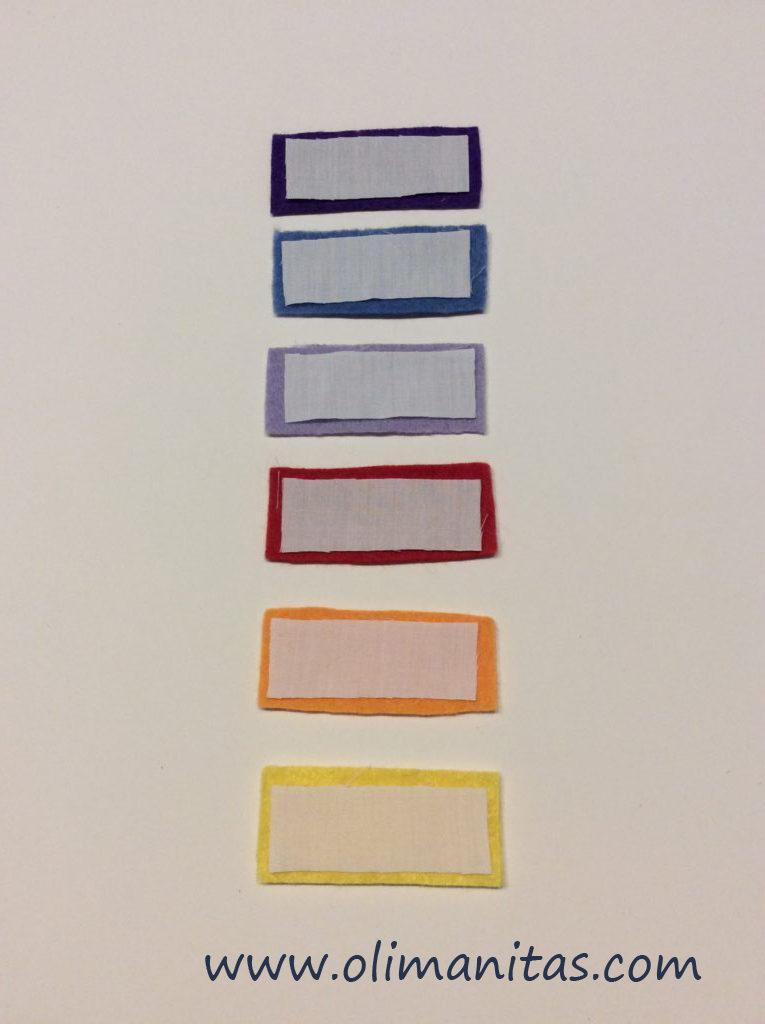 Recortamos 7 rectángulos de fieltro, en colores diferentes, uno por cada día de la semana.